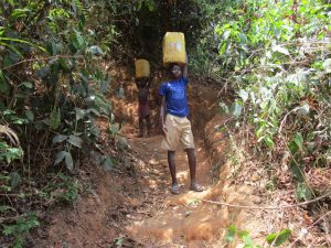 The Water Project:  Boys Carrying Water For The School