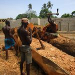 The Water Project: Mummy Ann's Pre-Primary School -  Men Carving Out Tree To Make A Boat