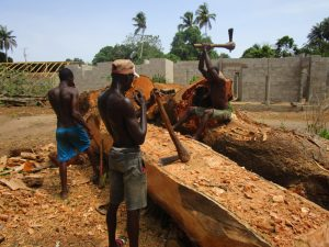 The Water Project:  Men Carving Out Tree To Make A Boat