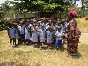The Water Project:  Students And Mrs Nsenesie