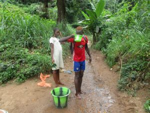 The Water Project:  Drinking Water From Stream
