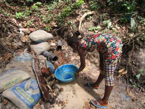 The Water Project:  Collecting Water At Improvized Spring