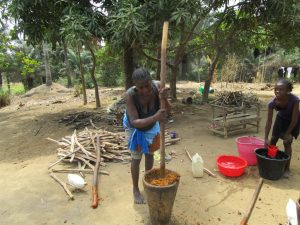 The Water Project:  Mashing Palm Fruit