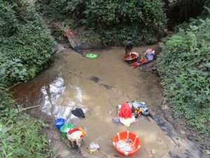 The Water Project:  Washing Clothes In The Water Source