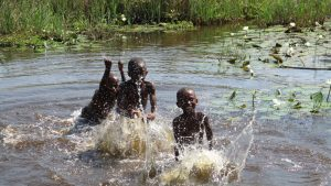 The Water Project:  Children Take A Bath In Swamp