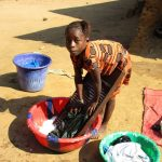 The Water Project: Lungi, Tonkoya Village -  Girl Launders Clothes