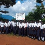 The Water Project: Ikumba Secondary School -  Students At School Sign