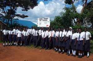 The Water Project:  Students At School Sign