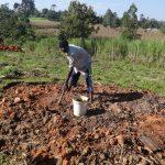 The Water Project: Bungaya Community, Charles Khainga Spring -  Kevin Omondi Raking Charcoal