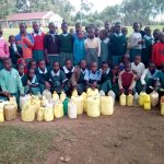 The Water Project: Bumbo Primary School -  Students With Their Jerrycans