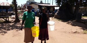 The Water Project:  Parents Carrying Water To School In Place Of Fees