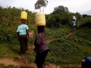 The Water Project:  People Carrying Water Home