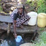 The Water Project: Bukhakunga Community, Mukomari Spring -  Fetching Water