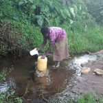 The Water Project: Kambiri Community, Sachita Spring -  Fetching Water