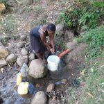 The Water Project: Eshiasuli Community, Eshiasuli Spring -  Fetching Water