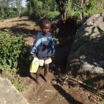 The Water Project: Bungaya Community, Charles Khainga Spring -  Child Carrying Water From The Spring