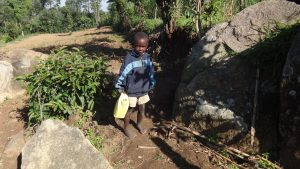 The Water Project:  Child Carrying Water From The Spring
