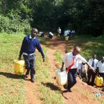 The Water Project: Ikumba Secondary School -  Carrying Heavy Water