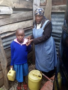 The Water Project:  A Little Girl At The Small Plastic Tank