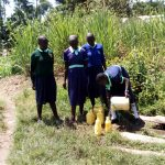 The Water Project: Mukama Primary School -  Fetching Water