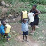 The Water Project: Eshiasuli Community, Eshiasuli Spring -  Carrying Water