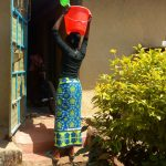 The Water Project: Lutonyi Community, Lutomia Spring -  Carrying Water Home