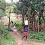 The Water Project: Buhayi Community, Nasichundukha Spring -  Carrying Water