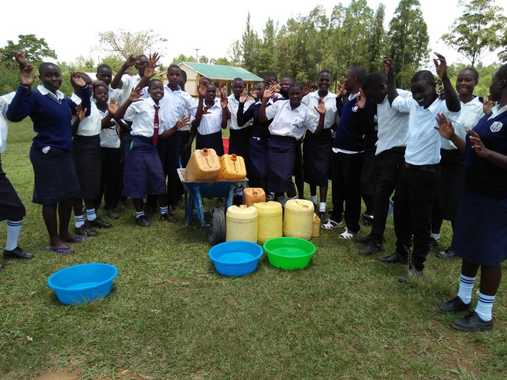The Water Project : 12-kenya19030-carrying-water-to-school