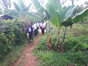 The Water Project:  Carrying Water To School