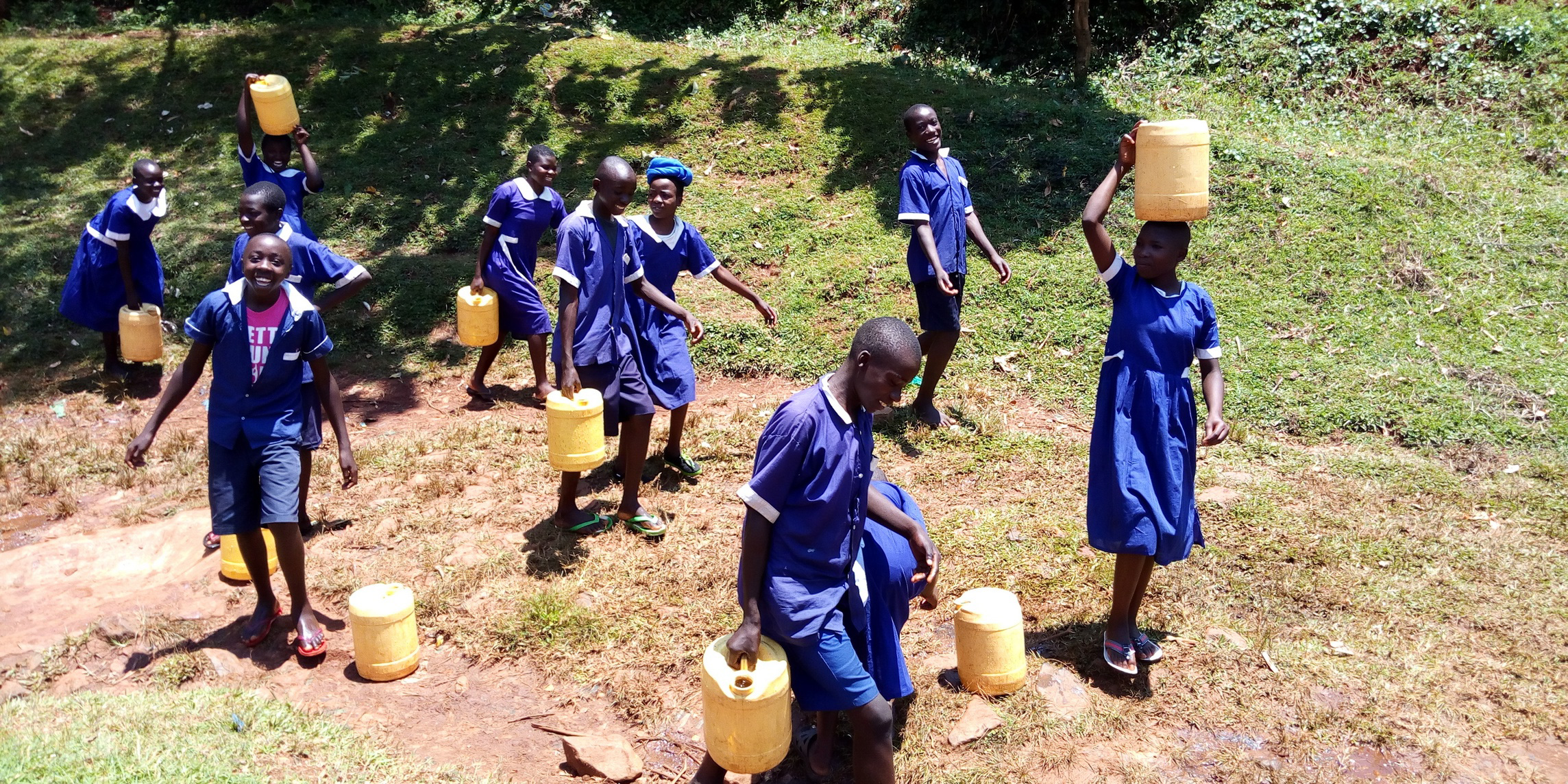 The Water Project : 13-kenya19078-carrying-water-back-to-school
