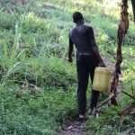 The Water Project: Bukhakunga Community, Mukomari Spring -  Carrying Water