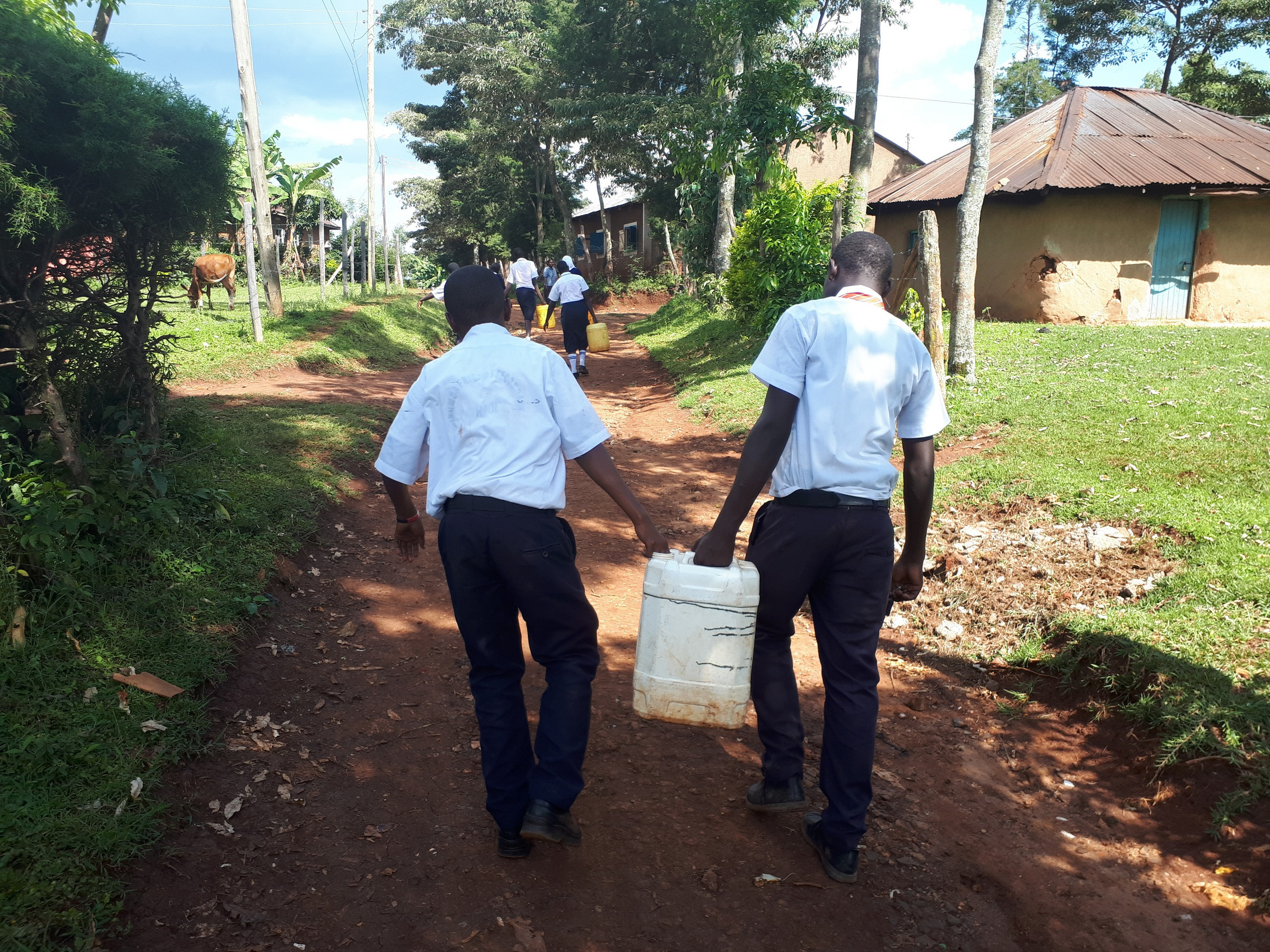 The Water Project : 14-kenya19054-carrying-water-to-school