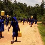 The Water Project: Demesi Primary School -  Carrying Water Back To School