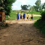 The Water Project: Kosiage Primary School -  Students With Jerrycans