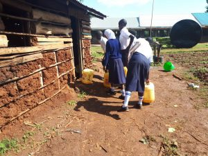 The Water Project:  Dropping Water Off At Kitchen