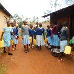 The Water Project: Hobunaka Primary School -  Delivering Water To Kitchen