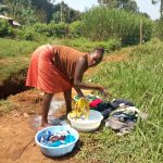 The Water Project: Lutonyi Community, Lutomia Spring -  Woman Doing Laundry Next To The Spring