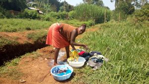 The Water Project:  Woman Doing Laundry Next To The Spring