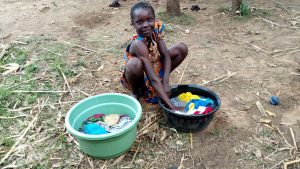 The Water Project:  Girl Washing Clothes By The Spring