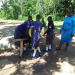 The Water Project: Enyapora Primary School -  Headteacher Sika With Students