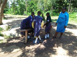 The Water Project:  Headteacher Sika With Students