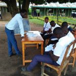 The Water Project: Bululwe Secondary School -  Students Reading Outside