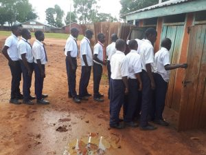 The Water Project:  Boys Lined Up At Latrines