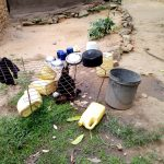 The Water Project: Hirumbi Community, Khalembi Spring -  Water Containers On Ground