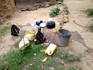 The Water Project:  Water Containers On Ground