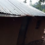 The Water Project: Kitulu Community, Kiduve Spring -  Roof That Helps Family Collect Rainwater