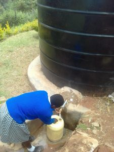 The Water Project:  Filling A Container To The Small Tank