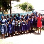 The Water Project: Mukama Primary School -  Students Posing At Gate