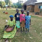 The Water Project: Eshiasuli Community, Eshiasuli Spring -  A Grandmother And Her Grandchildren