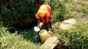 The Water Project:  Mrs Ayieta Fetching Water